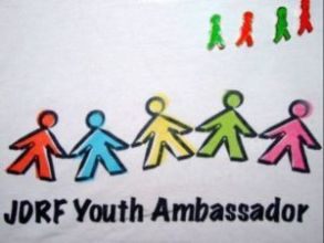 Lance's JDRF Youth Ambassador shirt, adorned with Jelly Baby lapel pins.